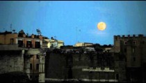 Full moon hovers over Roman cityscape