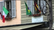 Sign titled Piazza Del Popolo above an awning