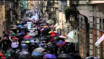 Cars traveling down umbrella filled Via dei Condotti
