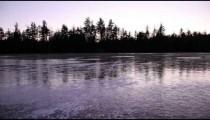 Still lake reflecting trees