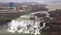 American Falls and Bridal Veil Falls at Niagara Falls with New York in the background.