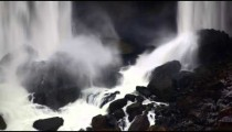 Close up of rocks at bottom of waterfall at Niagara Falls.