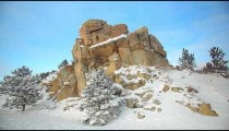 Winter Rock Formation with Pinetrees