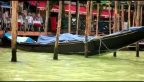 Tracking shot of gondola docks from the water