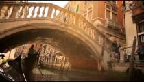 Gondolas passing under bridge