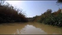 Brown, quiet water of Jordan river