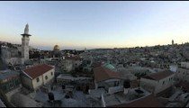 Tracking time-lapse of Jerusalem and the Dome of the Rock at dusk.