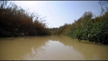 Slow-moving water of the Jordan river