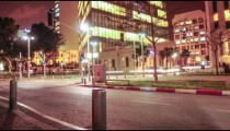Street-level tracking time lapse of a busy street at night