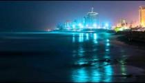 Night into day above a coastal city
