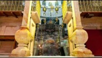 Entrance of the Edicule of the Holy Sepulchral time-lapse of tourists walking around.