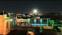 Time lapse of moonrise over Israeli rooftops