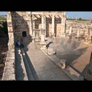 Dolly time-lapse of tourists at the old synagogue in Capernuam, Israel