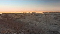 Panoramic shot of shadows moving across desert landscape