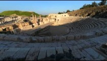 Time lapse of tour groups in an ancient Roman amphitheater