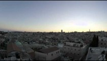 Time lapse of night falling over Jerusalem rooftops