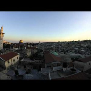 Tracking time-lapse of Jerusalem and the Dome of the Rock at sunset.