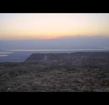 Time-lapse at sunrise in Masada, Israel.