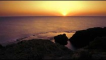 Time lapse of rocky coast while sun sets