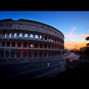Time-lapse of  the Colosseum and street traffic at sunset.