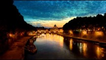 Vibrant sunset time-lapse of the Vatican City, from across the Tevere River.
