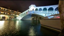 Rialto bridge time-lapse from side of canal.