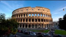 Daytime time-lapse of  the Colosseum  and street traffic.