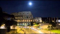 Moonlit time-lapse of  the Colosseum  and street traffic.