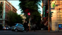 Time-lapse of traffic on a busy street corner in Rome, Italy.