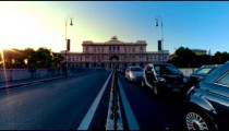 Time-lapse shot of the Palace of Justice from the bridge at sunset.