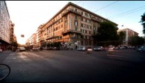 Time-lapse of busy traffic on a street corner in Rome, Italy.