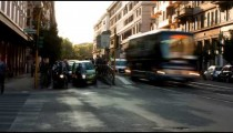 Time-lapse of a busy street and city trolley stop in Rome.