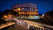 Nighttime time-lapse of  the Colosseum  and street traffic.