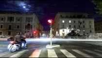Nighttime time-lapse of a busy street in Rome.