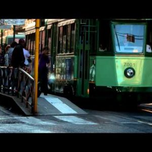 Time-lapse of a street and city trolley stop in Rome.