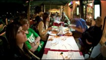 Time-lapse of tourist eating a meal.