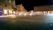 Heavy traffic in a city square in Rome, caught on time-lapse.