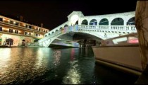 A Rialto bridge time-lapse from side of canal.