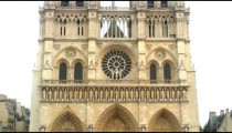 Royalty Free Stock Footage of Zoom out from the west rose window of Notre Dame Cathedral in Paris.