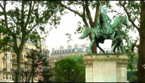 Royalty Free Stock Footage of Birds flying on and off a statue of a man on a horse in Paris, France.
