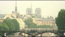 Royalty Free Stock Footage of Pedestrian bridge over the Seine with Paris skyline in the background.