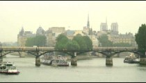 Royalty Free Stock Footage of Ferries going under bridges on the Seine in Paris, France.
