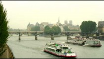 Royalty Free Stock Footage of Two ferries on the Seine River in Paris, France.