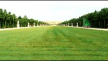 Royalty Free Stock Footage of Long lawn surrounded by statues and a walkway in Paris.