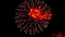 Royalty Free Stock Footage of Fireworks exploding in the night sky.