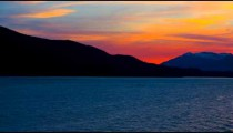 Traveling time-lapse of a silhouetted sunset from a cruise ship near Haines, Alaska.