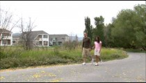 Clip of a couple holding hands going for a walk.
