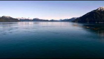 Traveling time-lapse of mountains around the ocean near Glacier Bay, Alaska.