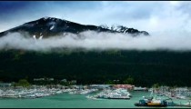 Time lapse high angle view of traveling clouds hovering above the Ketchikan boat port in Alaska.