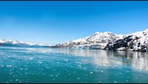 Slow traveling time lapse of snow capped mountains along Glacier Bay, AK
